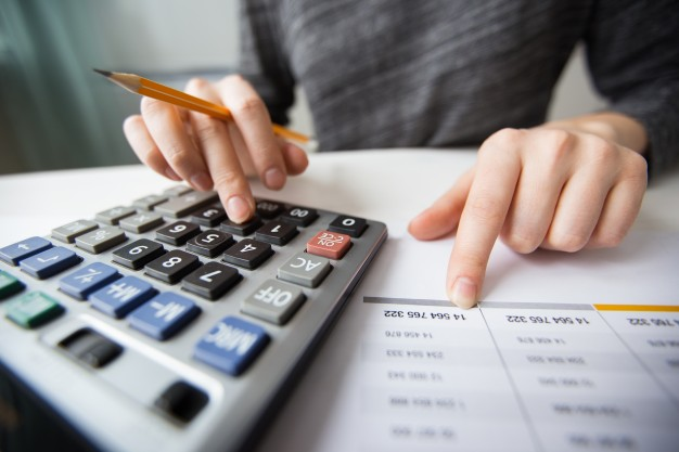 closeup of accountant hands counting on calculator 1262 3170